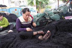 Mujer en la pesca Asia